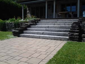 Natural stone wall and steps, with unistone walkway (A)